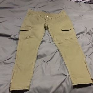 Olive green Levi's jeans w/ side pockets and zipp